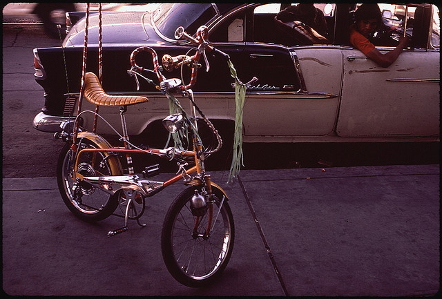 "It's Bike to Work Day! For today's Flashback Friday post in honor of our exhibit ""Searching for the Seventies""  we found this DOCUMERICA photo of a bike in El Paso, Texas, in 1972. Did you have a bike in the 1970s? Did it have a banana seat? Streamers flowing from the handlebars?"