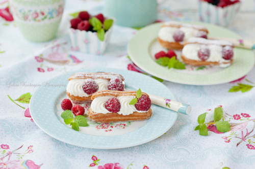glamprincess:  eclair with whipped cream and raspberries by kachergina on Flickr.