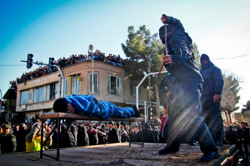 An Iranian officer lashes a man, convicted of rape, at the northeastern city of Sabzevar, Iran.
