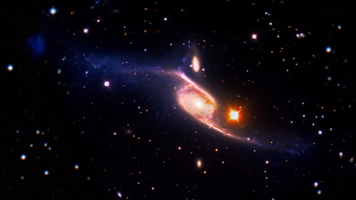 Largest spiral galaxy in universe revealed     NCG 6872's enormous size and odd appearance are the consequence of its gravitational interaction with a neighbor galaxy.