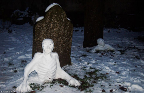 Here's a bit of morbid wintertime fun. Jen Hutchinson made the best of a blizzard that recently struck the southern UK by making these awesome undead snowmen who appear to be emerging from old graves in a disused graveyard in Bristol. Photo by Jonathan Pow [via Obvious Winner and Dailymail.co.uk]