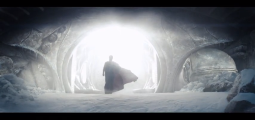 "Here, a screen cap from the recent Man of Steel. My favorite clip from that trailer. The kicker? I dislike a long caped Superman. That gripe is a little nitpicky but I just never took to the idea visually. I always thought that it made his silhouette too rectangular or triangular if the cape was in (what I like to call) the angel position. (Though Frank Quietly pulled it off nicely with a short cape for Absolute All-Star Superman)  There is also watching the cape fly off him like a flag, but that visual is a little too political for my taste. I like the idea of Superman using the baby blanket he arrived with as his cape, proof that he carries his planet's legacy with him and of the sacrifice that his parent's made to send him. The small blanket cape also occasionally is used like a matador's cape (I looked for a more proper term) which can reaffirm that people's champion feel to the character. (Even if aspects of actual bullfighting can be a bit barbaric) But that one bit of movie uses the cape in that ""Superman as messiah"" that plenty of artists have drawn, but have never managed to nail so perfectly as this movie clip. Maybe the cause is the light coming from the Fortress allowing him to be completely in silhouette giving the cape more of a robes feel. Maybe it's just that he is walking out of the Fortress like like the cave in the Easter story, even with a weird little circular design to the right like the rock that was blocking Jesus's tomb. It's just subtle enough (At least left alone as a visual, Russel Crowe's narration beats us over the head with it.) to get the message across without going straight out angel. Put shortly, I am really excited for this movie. P.S. If the captions don't work, First Screen Cap: Man of Steel 2013 Second and Third image by Jim Lee."