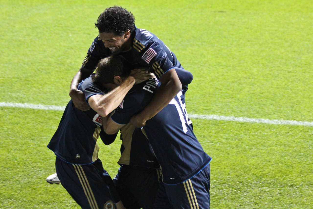 UNION VS. UNITED  Such a great photo after Seba's first goal. Sheannon looks so excited. Check out the rest of my photos from the game on Flickr. (Sheannon joins the celebration on Flickr.)