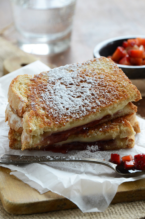 justbesplendid:   Strawberry Grilled Cheese {With Fresh Strawberry Balsamic Relish} by An Edible Mosaic Ingredients 1 teaspoon honey (preferably raw, local honey) 1 teaspoon good quality balsamic vinegar 1/2 cup (75 g) diced fresh strawberries 4 slices of your favorite bread (I like sourdough for this sandwich) 4 teaspoons butter, at room temperature 3 slices Land O Lakes® Deli American Cheese 3 tablespoons strawberry preserves 1 teaspoon powdered sugar, for garnish (optional) Instructions Mix together the honey and vinegar in a small bowl and stir in the strawberries; set aside for the berries to macerate while you make the sandwiches. Spread 1 teaspoon butter on 1 side of each slice of bread. Place 1 slice of bread (butter side down) on a cutting board; top each with 1 1/2 tablespoons strawberry preserves and 1 1/2 pieces of cheese. Place the remaining slice of bread on top (butter side up). Grill the sandwiches in a large skillet (or on a griddle) over low heat until golden on both sides. To serve, transfer each sandwich to a plate and sprinkle on a dusting of powdered sugar if desired. Serve the sandwiches hot along with the macerated strawberries to spoon on top.