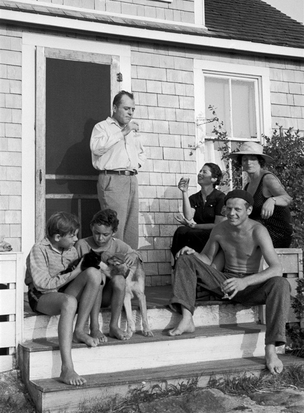 Jackson Pollock (seated R) sitting on the steps of painter Thomas Hart Benton's summer home with Rita Benton (white hat) and author Coburn Gilman (standing) in 1937.  Alfred Eisenstaedt / Time Life Pictures via Getty Images
