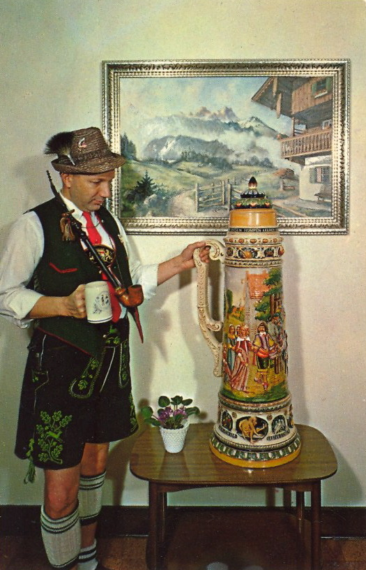 "bad-postcards:  REAL MEN CAN DOWN 15 SIX-PACKS   FRANKENMUTH BAVARIAN INNFrankenmuth, Michigan One of the world's largest steins. Made in Germany. Capacity—90 12 oz. bottles of beer or 8-1/2 gallons. Weight 75 lbs. The inscription on the stein reads as follows: ""Whoever can empty this tankard shall be called a real man."""