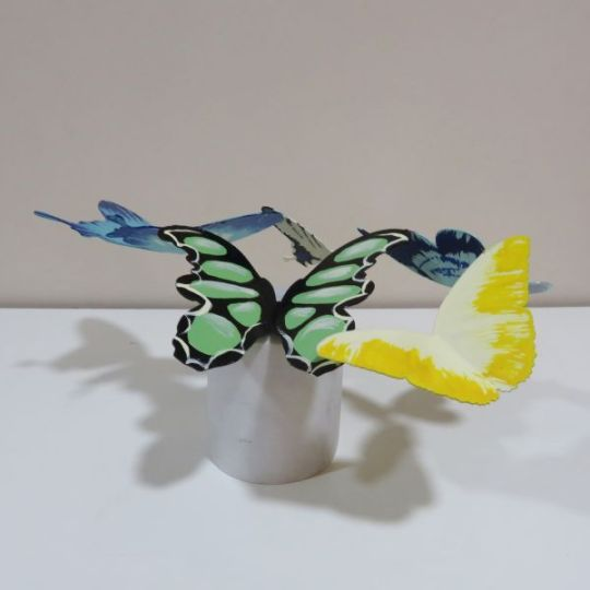 A sculpture titled Butterfly 19 (Colourful marble Mounted sculpture) by sculptor Liliya Pobornikova. In a medium of painted iron and in an edition of 1/1. #artist#sculpture#sculptor#art#fineart#Liliya Pobornikova#Iron#metal#unique#limited edition