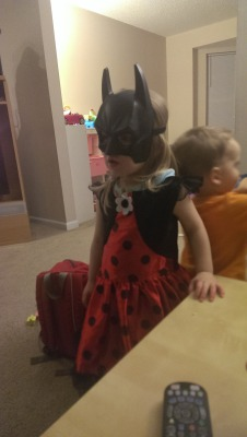 My daughter decided to mix up two different superhero costumes, and became Ladybug Batgirl.
