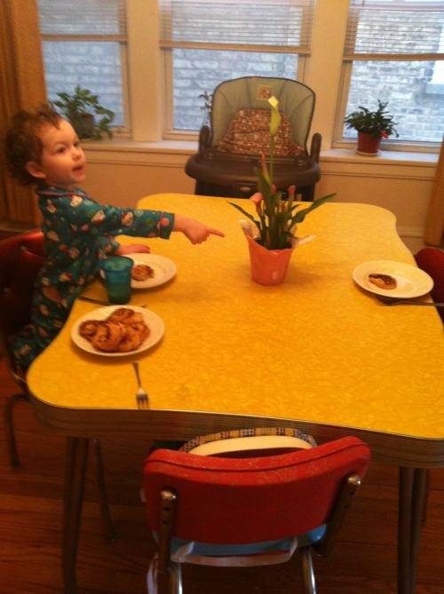 31 months old. Maybelle sets the table on her own. She whisked the eggs, added the cinnamon and nutmeg. She carried every thing to the table, set it up, and placed a French toast on each plate.