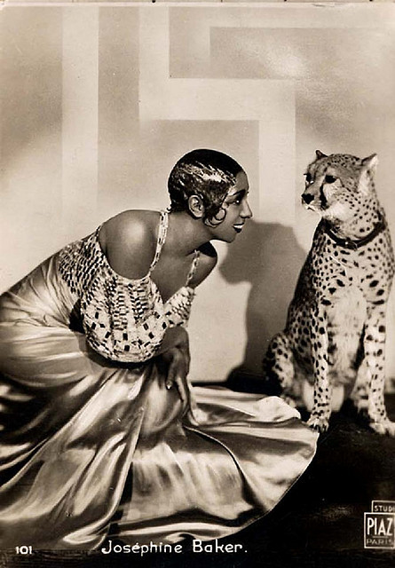 postraphaelite:  Josephine Baker, later known as 'Bronze Venus', 'Black Pearl' and 'Créole Goddess' was born in America in 1906 and later moved to France to become a singer, dancer, and actress. She was the first African-American woman to star in a major motion picture, and became famous worldwide. Though she grew up as a maid in wealthy white households she eventually became an exotic dancer in France, famously appearing in next to no clothing, and became a French citizen in 1937.  Ernest Hemingway referred to Baker as 'the most sensational woman anyone ever saw' and she received approximately 1500 marriage proposals in her life time. She became a muse for Hemingway, F. Scott Fitzgerald, Pablo Picasso, and Christian Dior. She had a variety of exotic pets including a cheetah named Chiquita, a chimpanzee named Ethel, a pig named Albert, a snake named Kiki, a goat, a parrot, parakeets, fish, three cats, and seven dogs.  When WWII broke out, Baker became a volunteer spy for France, and assisted the French Resistance by smuggling messages written in invisible ink on sheet music. She made great efforts to aid those in danger of enemy attack, sent Christmas presents to French soldiers, and smuggled information she gathered in Spain back to France by pinning notes containing the information on the inside of her underwear. She was awarded the Medal of Resistance with Rosette and later named a Chevalier of the Legion of Honour.  Baker also aided many civil rights movements by refusing to perform to segregated audiences and storming out of a club in Manhattan with actress Grace Kelly after she was refused service. She worked with the NAACP and spoke at a Washington march alongside Martin Luther King Jr. as the only official female speaker. Baker was actually asked by Martin Luther King Jr.'s widow to take his place as leader of the American Civil Rights Movement, but Baker declined on the grounds her twelve adopted children 'were too young to lose their mother'.  Baker died in 1975, four days after her final show, attended by such names as Mick Jagger, Shirley Bassey, and Liza Minnelli.