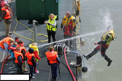 niknak79:  Kids playing with a water hose during coast guard demonstration.