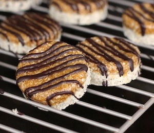 findvegan:  Homemade Samoas!  This is AMAZING. Click-through the link for vegan, GF samoas. :D Keep in mind that things are modifiable (though I'm totally making oat & rice flour this weekend) aaaand that agave nectar has been proven *not to be healthy, as once thought. :/ (use honey instead?) But in any case, these look great, and are likely amazing. Let me know if anyone makes them!