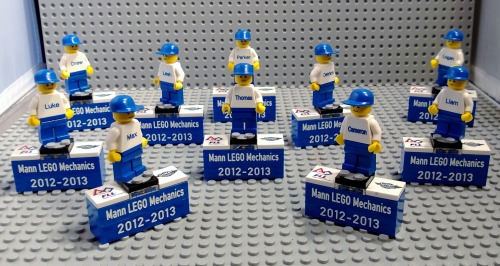 Trophies that we did for the FLL Team: Mann LEGO Robotics. Included was a mini-fig with each team member's name as well as FLL and Senior Solutions tiles.