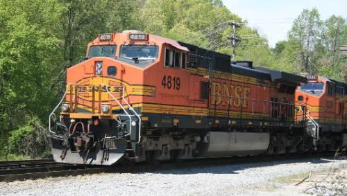 Warren Buffett's BNSF to test natural gas-powered trains Meanwhile, increasing domestic oil production (and shipping it by rail) is expected to spur the billionaire's profits.