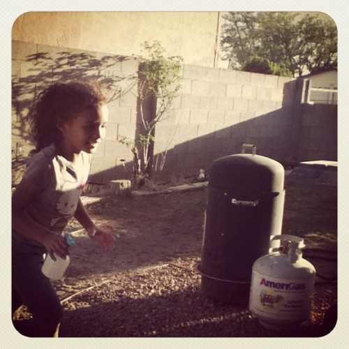 My little cousin playing with water :) I missed them