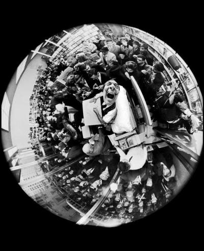 collectivehistory:  Salvador Dali at a book signing, taken with a fisheye lens, by Philippe Halsman, 1963.