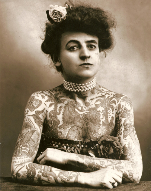 "wnycradiolab:  fortunamobilis:  Maud Wagner, the first known female tattooist in the U.S., 1911. In 1907, she traded a date with her husband-to-be for tattoo lessons. Their daughter, Lotteva Wagner, was also a tattooist. Photograph courtesy of Margot Mifflin, author of ""[Bodies of Subversion: A Secret History of Women and Tattoo](http://www.powerhousebooks.com/site/?p=13792).""  Damn.  I had no idea."