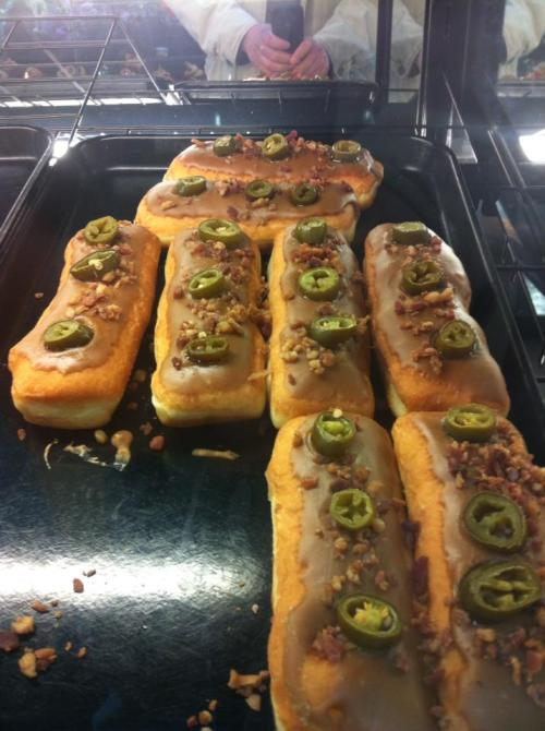 Maple frosted, bacon bits, jalapeno eclair/long johns (with your choice of Bavarian  custard, cream, raspberry, blueberry, or apple filling). Found at my local H-E-B Grocery Store, Austin, TX