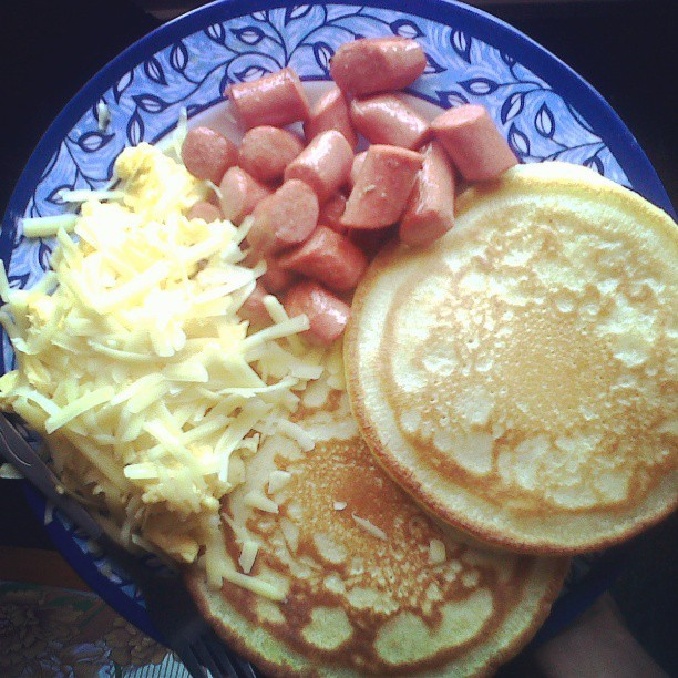 Breakfast this Morning. Pancakes, Eggs w/ Chese, Sausages & Pineapple Juice.