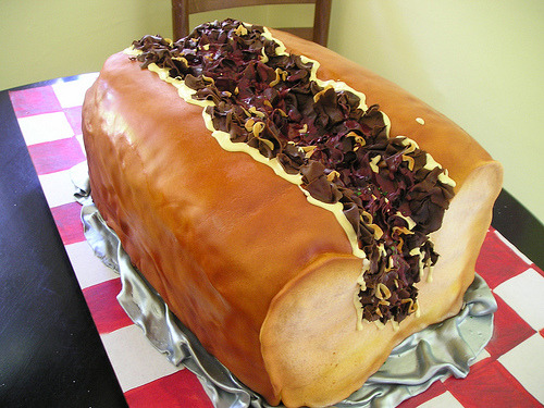 Hey Molly, I got you this birthday cake shaped like a cheesesteak!