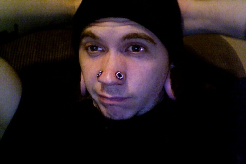 freshly punched and stretched 0g nostrils:D