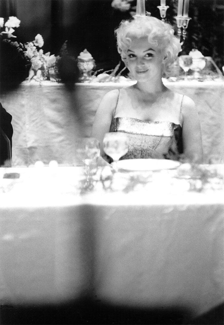 Dining Out Monroe posing at a restaurant in New York City in 1955.