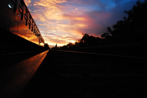 sunset at railstation kedungbanteng reflection light, pasundan train. the sky light