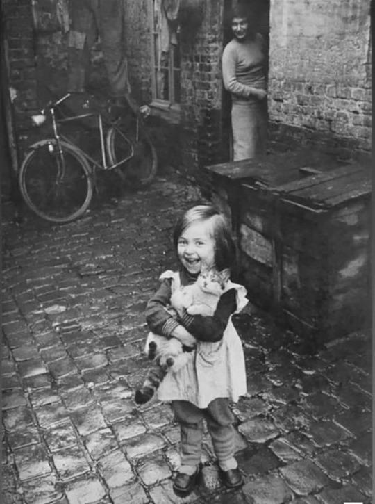 This young french girl showing off her cat ,1959. #aww #This young french girl showing off her cat  #1959.