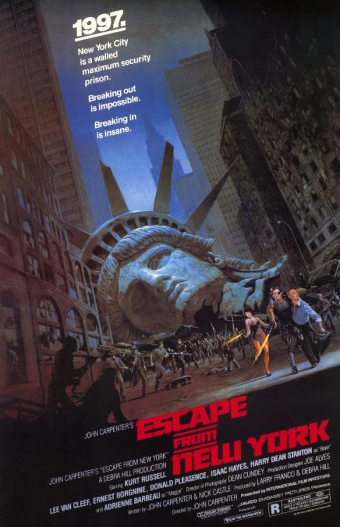 #503/#54 Escape From New York Decorated soldier turned criminal Snake Plissken (Kurt Russell) is given a chance at a pardon in exchange for rescuing the US President (Donald Pleasence) from within the now walled off island prison of Manhattan. Watching Lockout recently made me think I should really get around to finally watching this cult classic. I was a touch wary however because I didn't like Big Trouble in Little China at all and was unsure if another Kurt Russell/John Carpenter pairing would be my cup of tea. I shouldn't have worried though because this movie is wonderfully 80's and a ton of fun. Plissken is the quintessential renegade badass and I don't think it's possible to not enjoy watching what he gets up to. He fits with his environment so well that the first moment you see him on screen you instantly know this is going to be somebody interesting to watch for the next 100 minutes. Russell plays him wonderfully as well, in a very low key manner. Others might have been inclined to go over the top, but Russell's laid back attitude to the whole affair just screams 'fuck you' to every authority figure in this flick. Lee Van Cleef, Donald Pleasence and Isaac Hayes all do well in these various authoritative roles as well. Van Cleef is probably the best of the group; working as the kind of ying to Snakes yang. He's the road Snake could have gone down had he continued the way he had. They don't like each other but there's still a level of respect there despite their animosity. Pleasence makes a good cowardly president and Hayes, while not the deepest character, lends some presence to his role making him seem like a worthwhile adversary to Snake. Other than this the rest of the movie is 80's action at its finest and is what you would expect from a good ticking clock movie. The sets are also really good and the soundtrack is great. The opening credit music has got to be up there with the Terminator and Halloween for instantly resonating with the movie and locking itself forever within the recesses of your brain. I'm definitely going to be rewatching this one again. Well worth checking out. 4.5/5