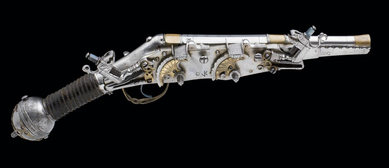ghost-of-gold:  A VERY RARE SUPERIMPOSED LOAD GERMAN WHEELLOCK BELT PISTOL DATED 1609, SIGNED VK, PROBABLYFOR VALENTIN KLETT OF SUHLwith swamped barrel formed in four stages, overlaid withbrass at the muzzle, median and the breech, the latter boldlystamped with the date and the barrelsmith's initials 'VK', flatlock stamped with the maker's initials 'VK' conjoined (NeueStøckel 4688) and retained by three side nails, fitted with twoelliptical external wheels each overlaid with an engraved giltbrass panel, moulded pans decorated with a scalloped designand with engraved sliding covers, engraved moulded dogschiselled with birds-of-prey on the spurs (restorations), rebluedtrigger, sprung moulded safety- catch opposite the lock, steelfull stock chiselled with a scalloped pattern over the fore-endon each side of the barrel, signed behind the tang with themakers initials 'VK' (an early repair behind the tang), the gripwith a later leather covering bound with plaited wire, ballpommel incorporating a hinged cap applied with a pierced giltbrass flower-shaped bracket, pierced gilt-brass trigger-guard,associated steel belt hook, and no provision for a ramrod
