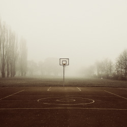 "How Basketball Has Changed My LifePart I of V — Hip-HopWho Am I? (What's my Name) — it's the first song I can really remember listening to and I can say it's played a significant role in the person I've turned out to be. When I was seven or eight, it would come off an old boom-box that played while I watched my big brother work out in our basement, religiously tracking reps and sets on a spreadsheet that couldn't have been so simple to build at the time. I think of it less nowadays but I had often felt like a product of my two older brothers rather than of my mother and father; a hopeful blend of someone who gave you an unequivocal answer that always turned out to be right somehow, who opted for patience over compulsion, and, of another whose altruism kept everyone warm, who intuitively embraced difference and chose not to ignore it. Listening to Snoop Dogg made me pretty oblivious to the coastal feud of the mid 90's and I'll admit it didn't help Biggie much that I had spent most of those years rewinding California Love over and over and over again until double-sided tape decks finally came along. Together, the two tracks gave everyone countless hours of joy and inspiration that I would spend in the backyard playing basketball with my brothers. And though I'd go on to hear Gin and Juice and Ambitionz Az a Ridah just as often, they never resounded over a game of ""American"" as well as the two I had come to know and love. The relationship between basketball and hip-hop went far beyond soundtracks however; sure Snoop and Tupac drove me to practice but basketball paved the way for acts, lyrics, and even subcultures I wouldn't have otherwise considered. Professional athletes like Kenny Anderson and Larry Johnson, basketball players I looked up to, were forewords to emcees such as Erick Sermon and LL Cool J through the wonders of ""NBA Superstars"", a FOX Home Entertainment VHS tape that would so shamelessly combine music videos with basketball highlights (think of Whitney Houston's Greatest Love of All mashed together with an afro-rocking Julius Erving dunking all over the place) which really isn't all that bad when you think about it. From there, replayed highlights and sing-alongs led to imitations and personal favorites; they opened the door to new VHS tapes which evolved towards compilations to play ball to and, inevitably, resulted in pre-game rituals and post-game cramming. I had gone from timidly discovering Warren G's Regulate before house-league play to suddenly blasting Ghostface Killah's Winter Warz out from a yellow school bus before road games. Interweaving basketball with rap was not just a recurring trend but an intensifying appetence. Before heading out, I would listen to music and focus on practice; I'd go play and think about the albums I had heard that day then finish playing and carry on with different parts of the albums, adjusting the music, tweaking my game, on and on until what emerged was, above all, a ridiculously untouchable eighteen-track mix CD (nineteen if you're lucky) and a completely changed attitude problem. What was it about hip-hop and basketball that worked so well? I think their roots are painfully humble but their skills are often so clouded by the market and its misguided values. They are both so largely admired for their commercial success and simultaneously appreciated on different scales for their levels of dedication and trust. They may be saturated with wannabes and charlatans but at their core, they are dominated by a mastery of all the right fundamentals conflated with a ton of substance and an ounce of flare. Maybe these are the traits that drew me in or maybe it was all just good timing. All I know is that by fourteen, I had basically run 19's Panasonic Discman into the ground (being too cheap to buy my own for the aforementioned road games) but if those buds weren't in my ears it's because there was a always basketball in my hands. Interesting Facts: Even though I grew up playing basketball to Who Am I? and California Love, it turns out these are pretty much the most awesomest jams for anything. Whenever Ready or Not by The Fugees is played, I envision a slow-motion alley-oop being thrown. Every. Single. Time. Shawn Kemp has the best highlight pack in ""NBA Superstars 3"" Of course, they made more than one ""NBA Superstars"", come on. Photo by: Matthias Heiderich"