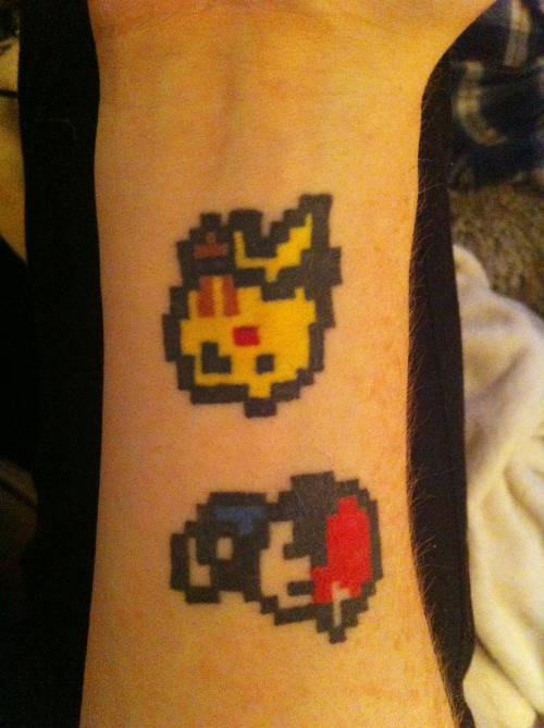 fuckyeahtattoos:  My original, pixelated Ash and Pikachu on my wrist :) I got it done at Ink vs Steel in Leeds, UK, although I didn't actually know the tattooists name :( it was my first one and my favourite! www.herlipssinksships.tumblr.com