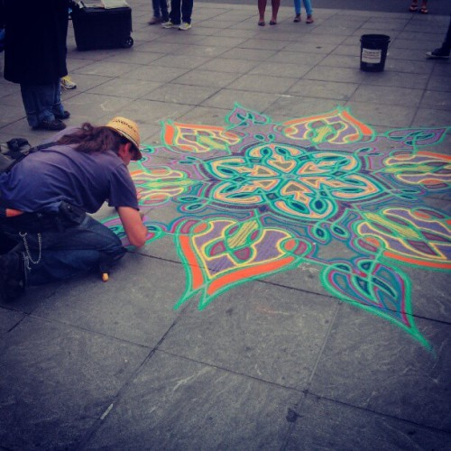 Chalk artist at work in Washington Square Park.