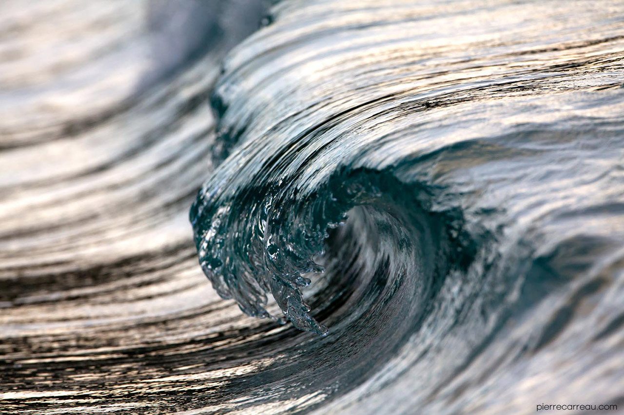 "archiemcphee:  These awesome photos, in which rolling waves appear to be both perfectly frozen in time and miraculously made solid, are the work of French photographer Pierre Carreau. Carreau ""shoots waves with a variety of high speed cameras using various macro and wide angle lenses, capturing water shapes that appear more sculptural than liquid."" Visit his Pierre Carreau's website to view many more examples of his amazing work. He also offers prints of some of his images via Clic Gallery. [via Colossal]"