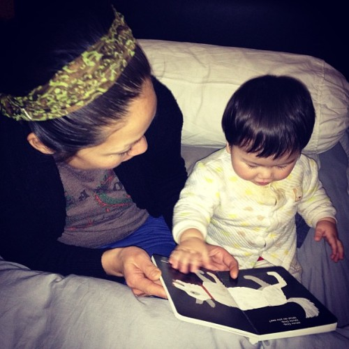 Reading with mommy.
