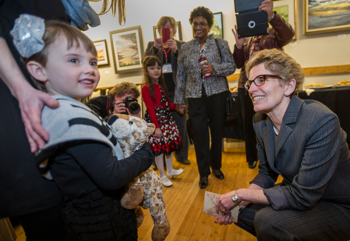 BELLEVILLE, Ont. (02/04/2013) — Kathleen Wynne, Premier of Ontario, meets with birthday girl, Daisy Sprung, five, during her visit to Belleville, Ont. on Tuesday, April 2, 2013. Photo by Justin Chin