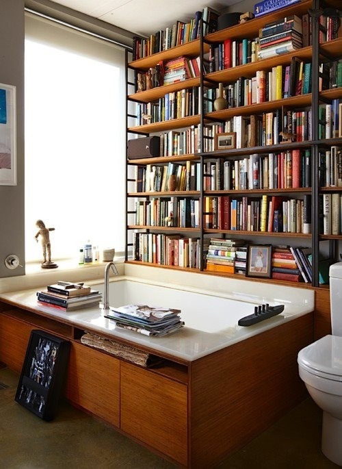housingworksbookstore:  apcalvin:  thepreppyyogini:  A tub in a library. What a fabulous idea.  This is all I've ever wanted. Although the humidity would ruin those poor books.   I want to go to there.