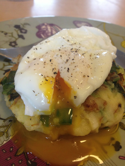 Poached egg on spring onion and potato cakes.  I made the cakes by mixing some left-over mash with a large spring onion, lightly fried, salt and pepper. I formed this into a cake and fried in a teaspoon of rapeseed oil while the egg was poaching. Quick and delicious.
