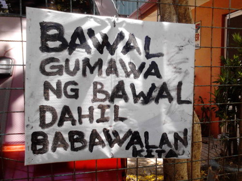 "capturedinterestingness:  Somewhere in GMA, Cavite, Philippines. The sign says, ""Bawal gumawa ng bawal dahil babawalan kita. (You're not allowed to do what is not allowed because I will not allow you.)"""