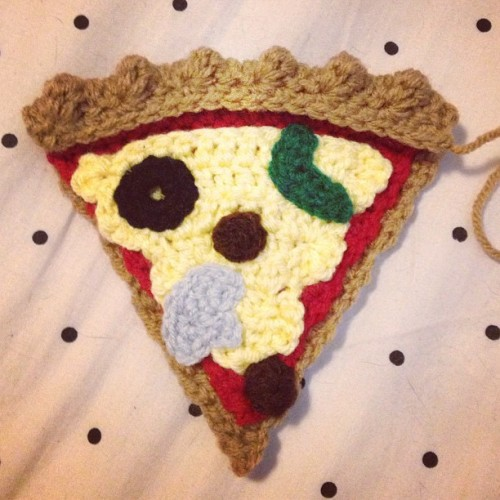 Crochet pizza slice! The beginnings of a very exciting piece. #crochet #pizza #slice #sausage #handmade #yarn #hustleandsew #food  (at Crochet Castle Dos)