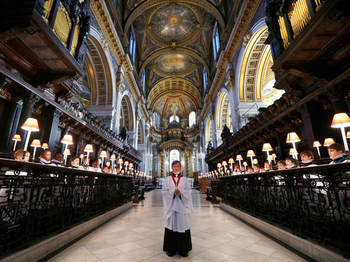 Harry Jackson, 13, the head chorister at St Paul's Cathedral School, sings carols during a photo call. The choir will sing to more than 20,000 people during the Christmas period  Photo: Andrew Winning
