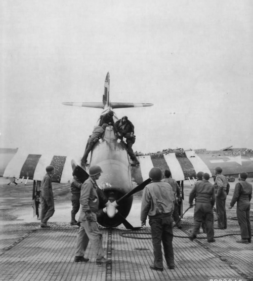 A P47 Thunderbolt after landing with a wounded pilot and fragmentation bombs on, 16 June 1944 Cardonville, France.