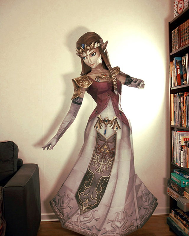 "Life-Size Princess Zelda Papercraft This is a real life-size Princess Zelda papercraft that stands at 170cm (around 67 inches (5'6"" ish)), built by a DeviantART user who devoted a lot of time, minidelirium. The original craft was created by PaperJuke here. Feel free to download it if you want to spend a lifetime trying to impress your other gamer friends. According to minidelirium's DA post:  the cutting took 88h and the folding and building took 138h. I made a big mistake in the beginning and printed her on 120g paper, so I had to do it all over again in 160g and 200g paper. I'm very satisfied with the result and look forward to giving her to a distant friend. she is about 170cm tall.  That's a lot of paper and a lot of time. Check it: Our quick look at The Legend of Zelda: Hyrule HistoriaBuy it: The Legend of Zelda: Hyrule Historia Hardcover ($20!)"