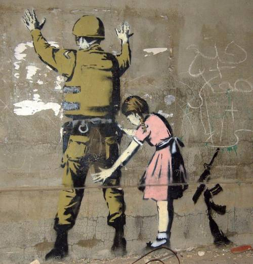 f-l-e-u-r-d-e-l-y-s:   Banksy, the street artist  Banksy is a England-based graffiti artist, political activist, film director, and painter. His satirical form of street art and subversive epigrams combine irreverent dark humor with graffiti done in a distinctive stenciling technique. His form of art is something I really like.