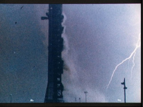 "jtotheizzoe:  Lightning Launch Speaking of awesome lightning, did you know that Apollo 12's Saturn V was struck by lightning less than a minute after launch? The bolt threw the navigation computer into chaos and then traveled down the energized exhaust plume. Read about the white-knuckled minutes, the near-abort and controlled self-destruct that almost happened. Until a young  flight controller suggested they flip ""SCE to AUX"". (via Universe Today)"