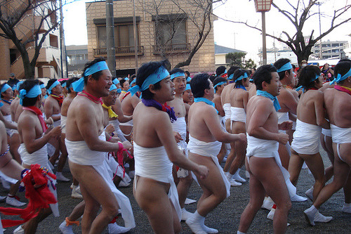 Hadaka ni narimashou! (Let's get naked!) During Kounomiya Hadaka Matsuri thousands of barely clothed men line the streets of Inazawa City, Aichi, Japan, in the hope of touching a completely shaved and totally naked man (or Shin-otokoa) as he passes through the city streets on his way to the Kounomiya Shrine. Shinto tradition believes that the Shin-otokoa absorbs all bad luck and evil deeds from the men who touch him. More on Kounomiya Hadaka Matsuri by Somewhere in the world today… Picture: Hadaka Matsuri by .A.G.M., on Flickr