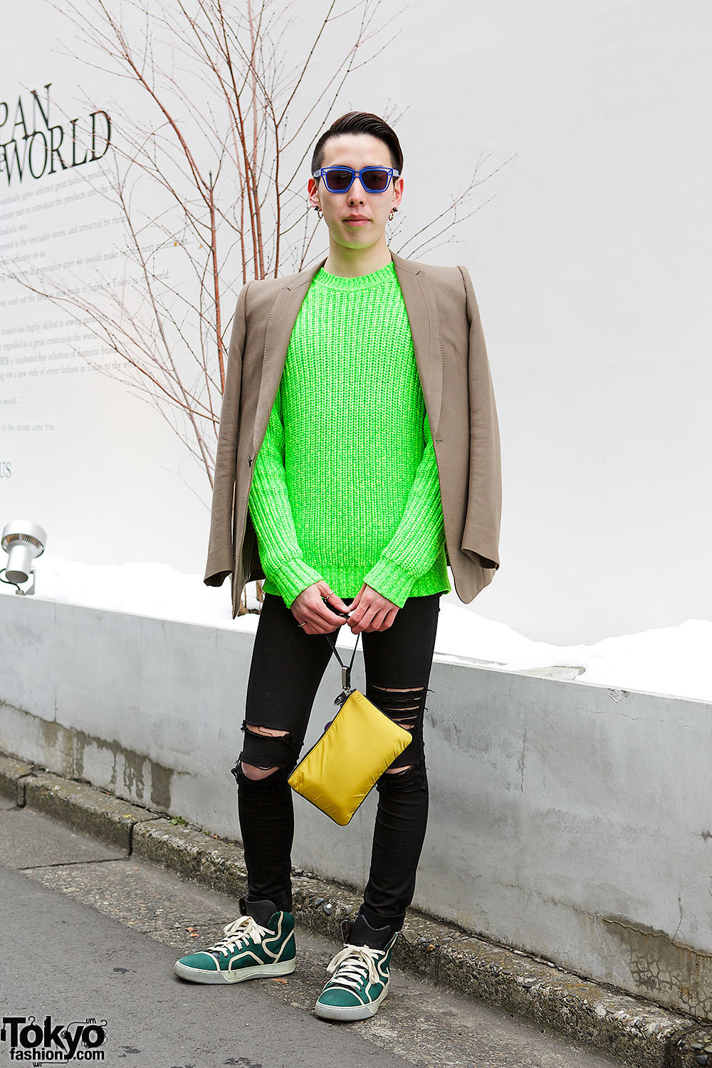 Ryo in Harajuku with a neon Kenzo sweater under a Julius blazer, ripped skinny jeans, a Jil Sander clutch & Lanvin sneakers.
