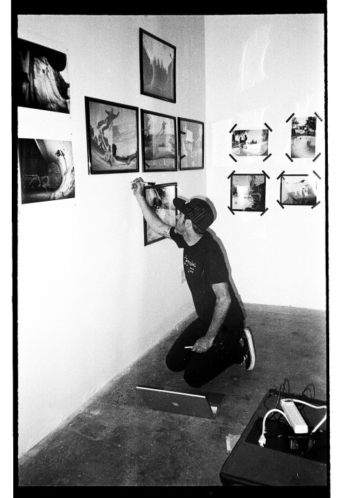Jai, at the Seeing Things Gallery, doing work that the interns should be doing. Darn lazy dawbs.