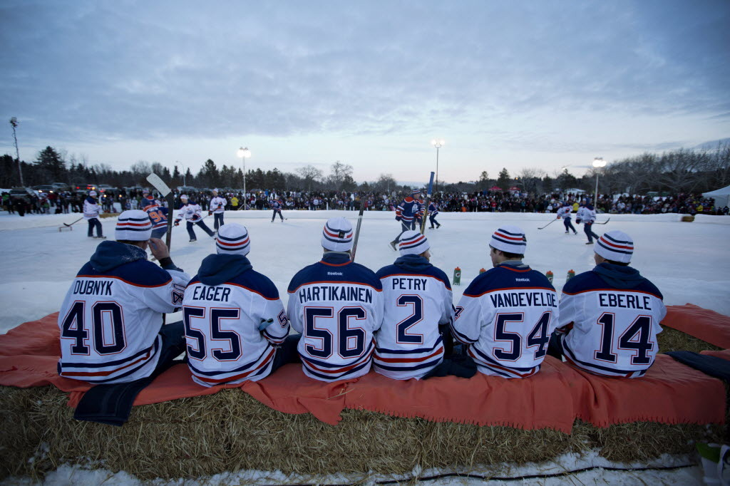 sportnationalpostsports:  Edmonton Oilers sit on bales of hay as they wait their turn to play in an game of outdoor shinny after the Oilers first day of NHL training camp in Edmonton, Alta., on Sunday. (Photo: THE CANADIAN PRESS/Jason Franson)
