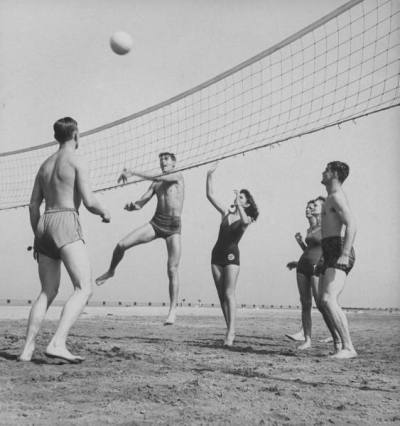 On-leave servicemen and their girlfriends playing volleyball at North Ave Beach, 1943, Chicago